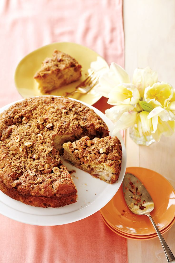 Rhubarb Coffee Cake—Studded with juicy pink rhubarb and topped with a crunchy nut streusel, this cake is perfect for spring brunch, snacktime or dessert.