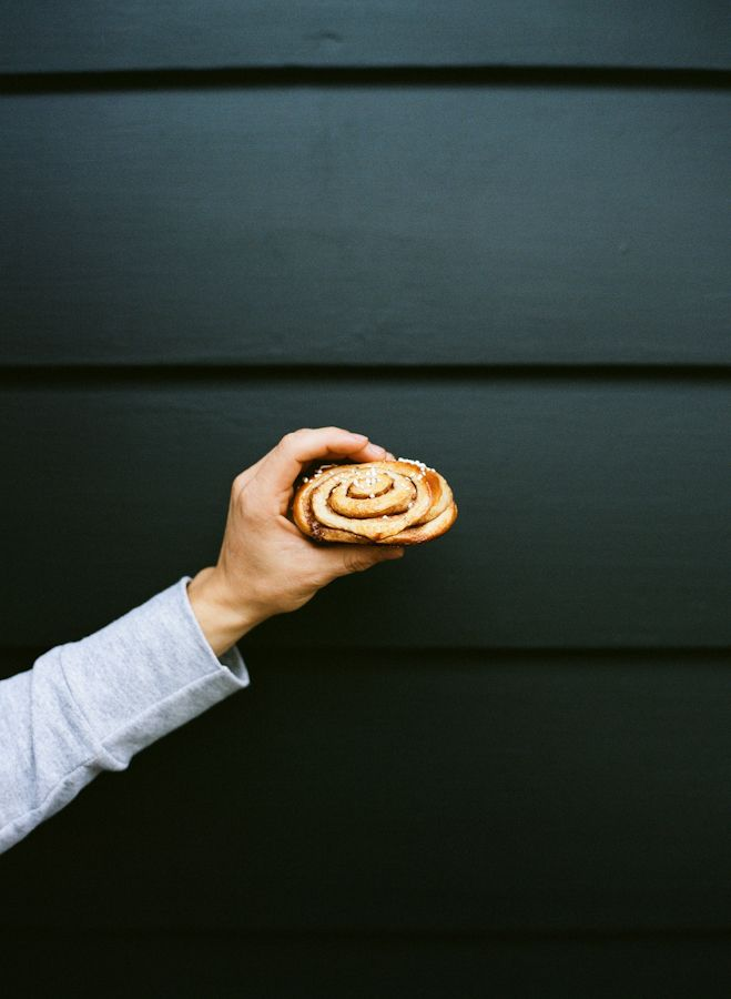 A generously-sized Finnish cinnamon bun, aka a piece of pulla. Pulla is the simple, sweet dough that gets turned into individual buns or into a loaf, often braided. Pulla -- in its whole, loaf-from, is essentially Finnish coffee cake. Pearl sugar is often sprinkled @ top!