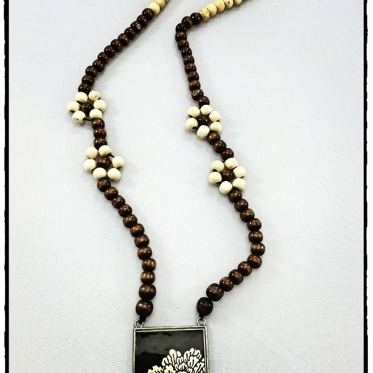 Flower Power!  Chocolate and cream wood bead long necklace with flower pendant.