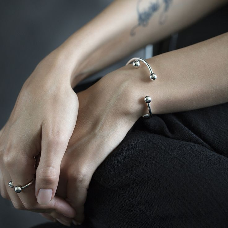 Silver ring and bracelets with a twisting element. You can put any pendant on them. by ResDepot