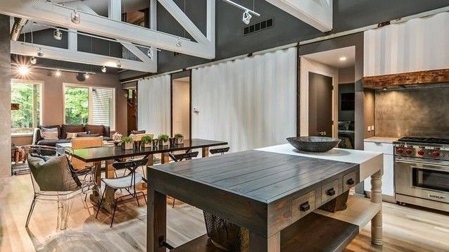 Kitchen with exposed shipping container walls