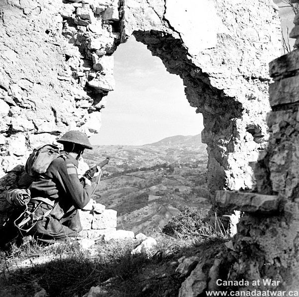 Italy (Misc.) - At Colle d'Anchise, west of Campobasso, Private Maurice White of The Loyal Edmonton Regiment keeps watch.