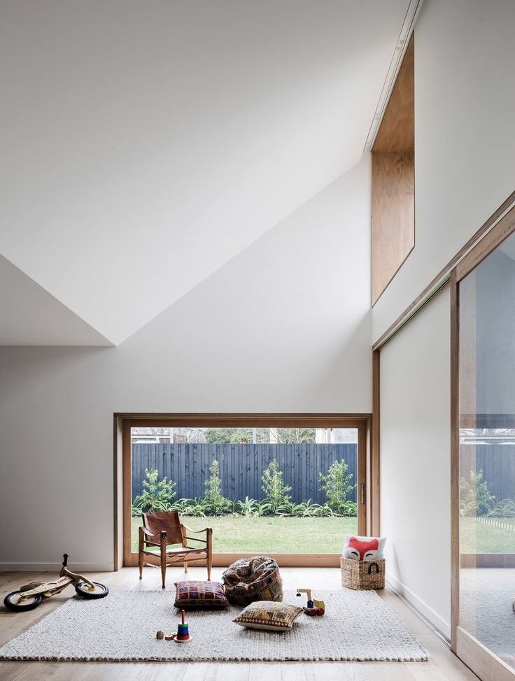 - timber framing around doors and windows - Hoddle House in Melbourne by Freedman White Living room takes advantage of natural lighting and circulation.