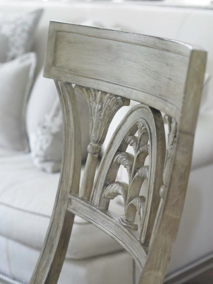 The curvy chair lends a note of Old World charm with a unique finish and a lovely carved wood back. - Traditional Home ® / Photo: Emily Followill / Design: Lillian August