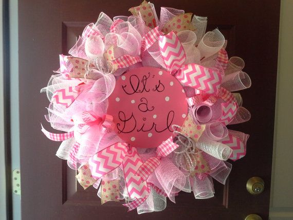 Its a Girl! How sweet for a baby shower gift! Made of plaid, light pink, and white deco mesh, this wreath is eye catching way to decorate for the occasion. Its thick and full, but Very light weight though.    Available for immediate shipping.     Do not hang over crib or within babys reach.    All my wreaths are made with the highest quality materials and made with love. All items are wired for durability. Okay for outside on a covered porch or stoop. Just hang with 3M command hooks, a 5lb…