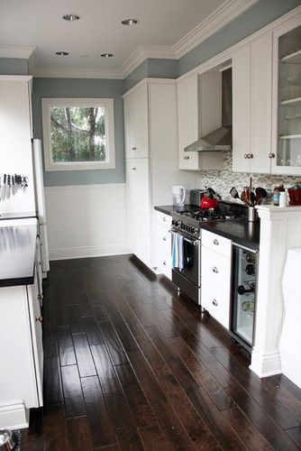 An option for how to do the oven hood  Blue gray kitchen with black counter tops and white cabinets contemporary kitchen