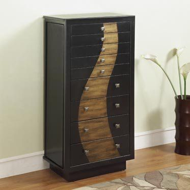 The Gold Leaf Jewelry Armoire is a unique storage piece for all of your beloved treasures. Featuring a flip top with mirror inset, side storage cabinets and deep storage drawers, this piece is the perfect storage solution for all of your needs. Finished in a dark black with a gold leaf curve down the front, this piece would make a wonderful addition to any room.