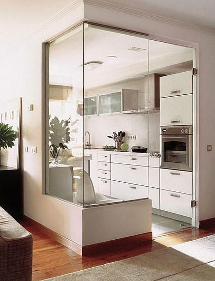 Smart use of glass to open the sight and avoid the claustrophobic feeling of a small space- small kitchen