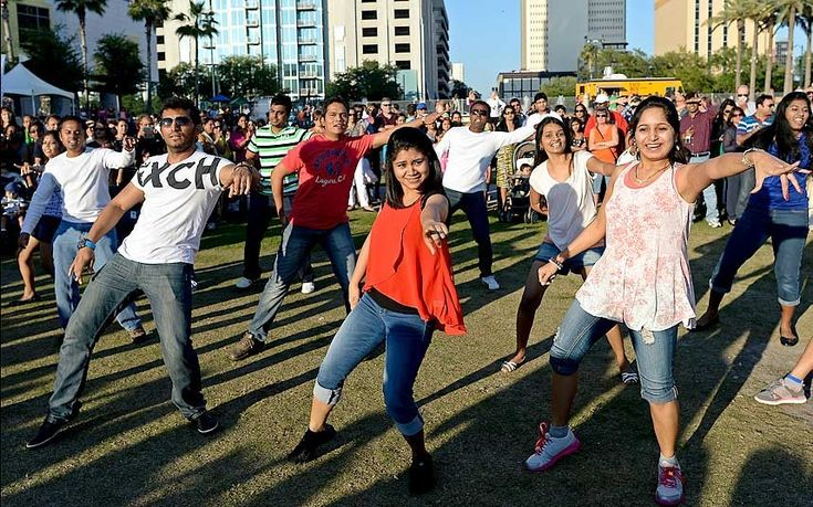 Crowd participants dance at the IIFA Stomp event, the opening act for the 15th International Indian Film Academy (IIFA) Awards at Curtis Hixon Park in Tampa, Florida