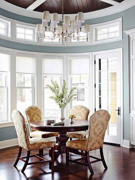 dining room paint color idea. Comfortable Elegance. Tall chair backs with the round table.