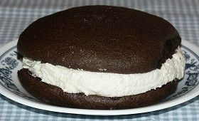 1 cake mix (any chocolate cake mix or devil's food chocolate cake mix)  1 (3-ounce) package of instant chocolate pudding  Whoopie Pie Filling (see recipe below):  1 cup solid vegetable shortening*  1 1/2 cups powdered (confectioner's) sugar  2 cups Marshmallow Fluff**  1 1/2 teaspoons pure vanilla extract