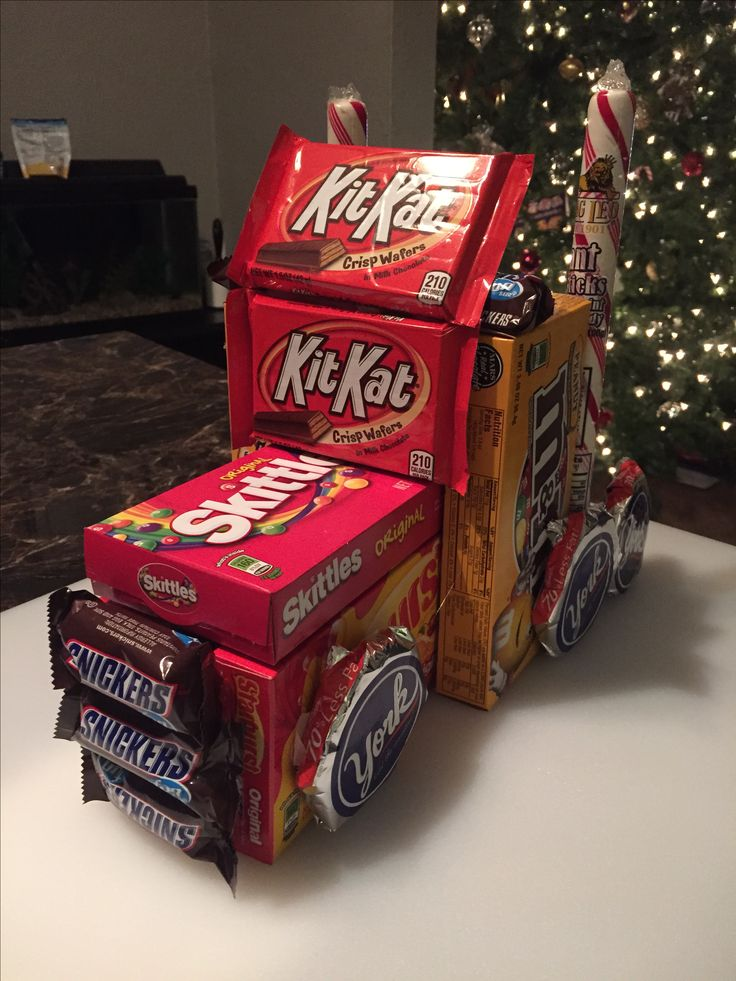 Semi truck made of candy. Dollar store candy boxes and candy canes hot glue gunned together as a Christmas gift to my husbands boss :)