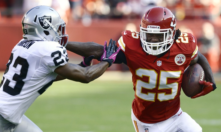 Kansas City Chiefs running back Jamaal Charles battles Oakland Raiders defensive back Joselio Hanson. Week 8 2012 Season
