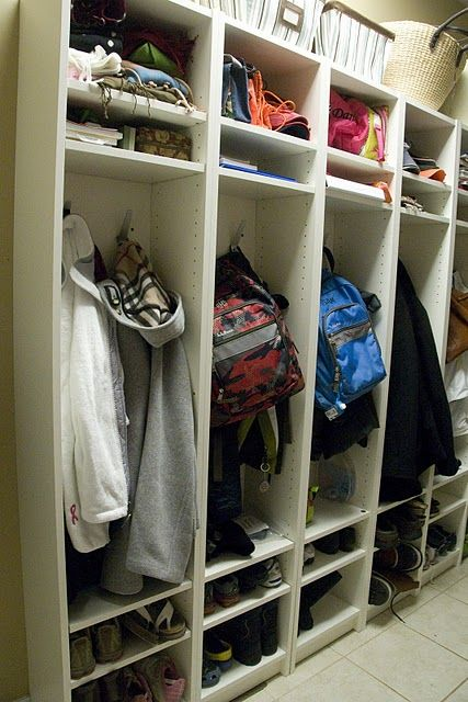 This is genius - using IKEA Billy Bookcases (the tall thin ones at $34) to make mudroom lockers.  They look great!