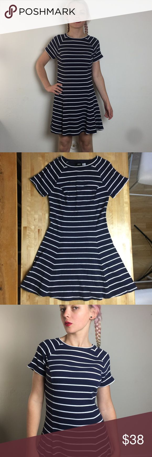 """BDG L navy/white striped cap sleeve mini dress Features a stretchy, body-hugging fit, ribbed fabric, a scoop neck, and a circle/skater-style skirt. Fabric content is 78% cotton, 18% rayon, 4% spandex. Made in Vietnam. In good used condition. One tiny bleach spot as pictured (nearly unnoticeable). No pilling, fading, or holes.  Measurements laid flat are approx. ("""") : Armpits across: 15 Waistline across: 14 Shoulder to hemline: 23   Armpit to hemline: 32.5 Urban Outfitters Dresses Mini"""