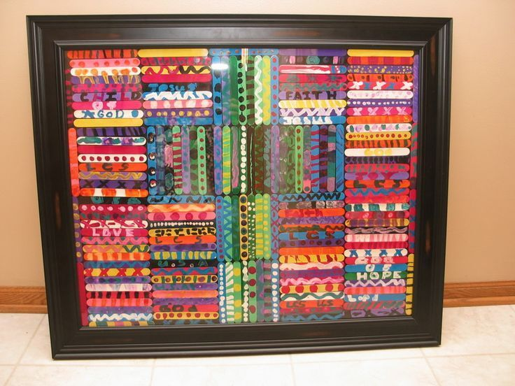 each student paints a popsicle stick and they are arranged to make a bigger piece of art.