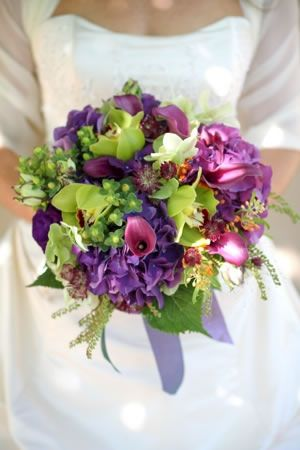 The bridal bouquet included purple hydrangea, calla lilies, and green cymbidium orchids. By Pat Gibbons Floral Designs.