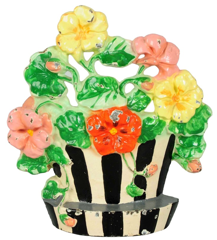 """April 19 & 20 Auction. Cast Iron Nasturtiums Flower Doorstop. Made by Hubley and numbered """"221"""" Bright vivid paint."""