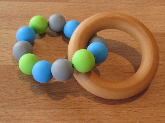 A beautiful natural & colourful teether that your baby will love!  The wooden ring is made from natural untreated hardwood and has been sealed with my own bees wax.  The ring of beads are made from 100% food grade silicone. They are BPA and FDA free making them a great option for your baby as they have no nasties.