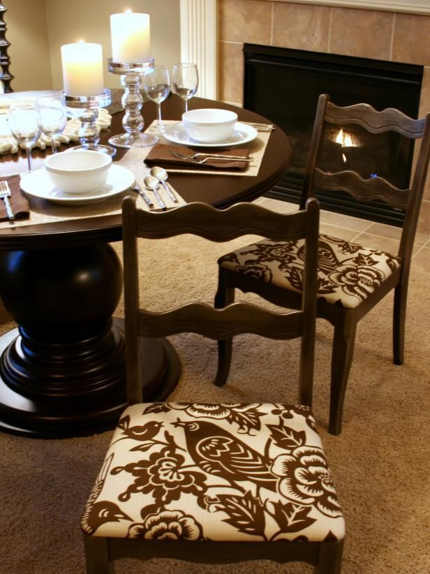 Newly upholstered dining room chairs by a fireplace.