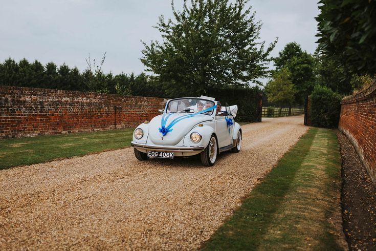 What a classic! Photo by Benjamin Stuart Photography #weddingphotography #vintagecar #weddingcar #vwbeetle #weddingday #lillibrookemanor