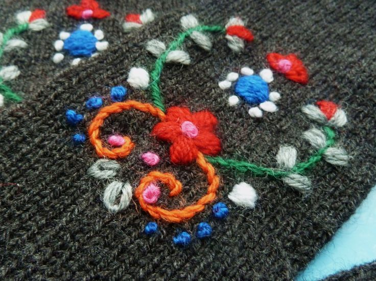 Detail from embroidered mittens by www.bonthuishouden.nl