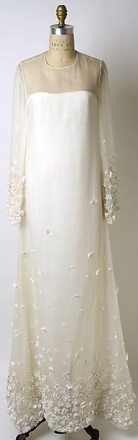 Wedding ensemble Design House: Oscar de la Renta, Ltd. (American, founded 1965) Designer: Oscar de la Renta (American, born Santo Domingo, Dominican Republic, 1932) Date: 1967 Culture: American Medium: silk, glass Dimensions: Length at CB (a): 61 in. (154.9 cm) Length (b): 16 in. (40.6 cm) Credit Line: Gift of Mrs. Minnie Cushing Coleman, 1995