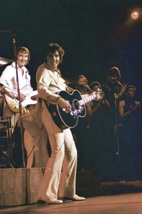 Elvis in concert. He seems so happy and content when he's up there