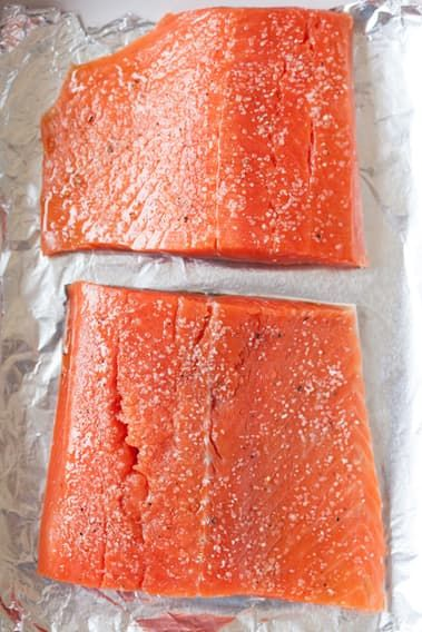 "If you want ""easy, fancy,"" it doesn't get much better than roasted salmon fillets. It can be a mid-week date night, an al fresco meal with friends, or dinner with the in-laws, and salmon will rise to the occasion. Today, we're showing you the easiest, simplest way to cook salmon in the oven. It's the kind of recipe to keep in your back pocket — though it's hardly a recipe at all. Make it once and you'll never wonder what to do with salmon again."