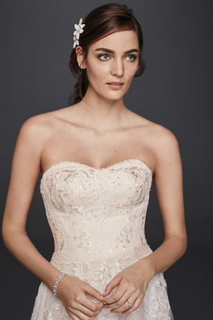 Soft panels of floral and scalloped lace fall gracefully from the appliqued bodice of this sweetheart A-line petite wedding dress. Hand beading and a blush underlayer give the look a warm glow.   Melissa Sweet, exclusively at David's Bridal  Petite  Polyester  Sweep train  Back zipper; fully lined  Dry clean  Imported  Also available in Regular Plus Size Extra Length and Plus Size Extra Length