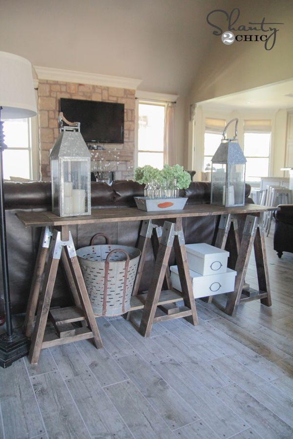 DIY:  How to Build this Sawhorse Sofa Table - using sawhorse hardware and stock lumber. This post has free plans to download, plus a tutorial showing every step - via Shanty 2 Chic