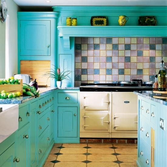 Turquoise cabinets + soft tile palette is so lovely!  I am doing this to my kitchen this spring except I am putting copper tiles instead of the pastel ones...don't care for the floors here...but can't think of what to do instead of whats in the pic...suggestions???