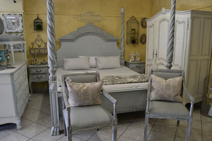 Dramatic four poster bed in a soft blue