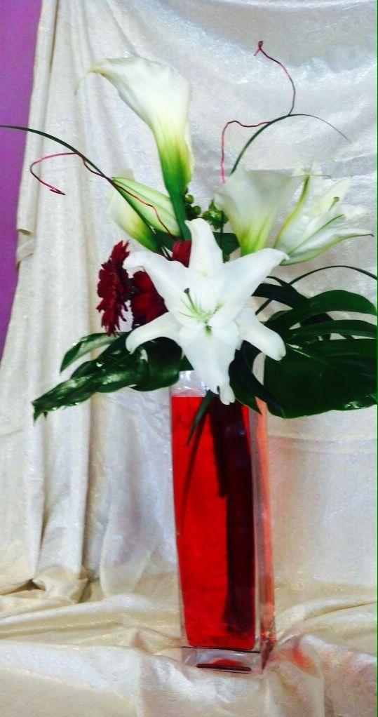 Tall centerpiece. Toronto/GTA florist  #white #lilies #green #red #vase