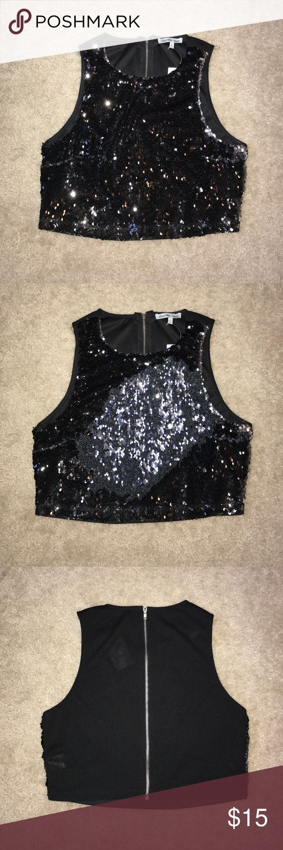 2 toned sequin crop top 2 toned sequin crop top. Rub the sequins one way and it turns black, rub the sequins the other way and it turns silver. Zip up back. NWT. Charlotte Russe Tops Crop Tops