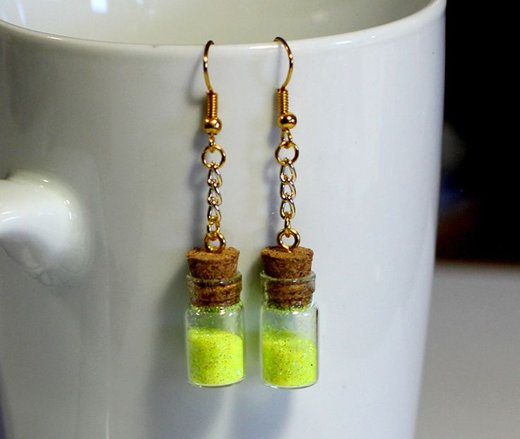 Neon glitter in a bottle earrings. Do you ever have glitter emergencies? I most certainly do. $20 . Get the baddest most unique handmade jewelry only at www.ugochi.xyz
