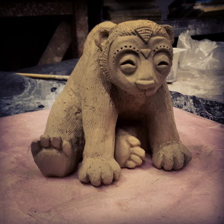 original clay sculpture of bear prepared for mould making