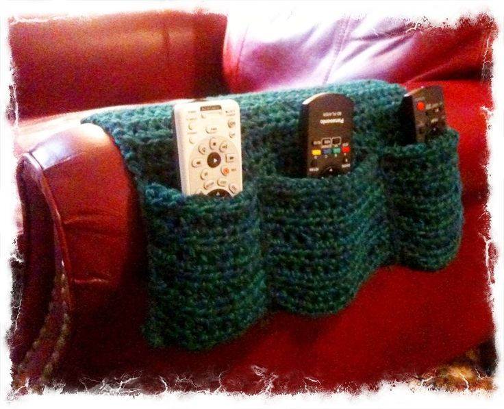 I used some left over yarn to create this arm chair caddy for remote controls. I used a half double crochet stitch and it is 27″ long with the fold over part.