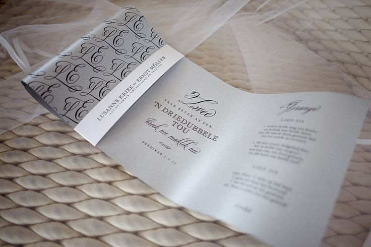 Order of service, designed as a bow, to tie in the the black tie theme. (photography: janib.co.za)