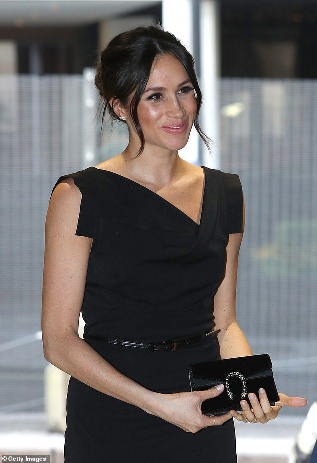 14b052b4f In April Meghan attended the Women's Empowerment reception at the Royal  Aeronautical Society, rocking a black power dress with an asymmetric  neckline and ...