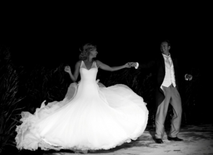 Holly Branson swirling in her silk tulle Jane Hill Wedding Dress on Necker Island