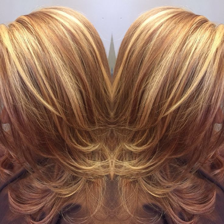 perfect warm brown lowlights and golden blonde highlights. Highlight service performed by Krystal Dupree. Check out our website www.salonrougega.com for more info on color services.
