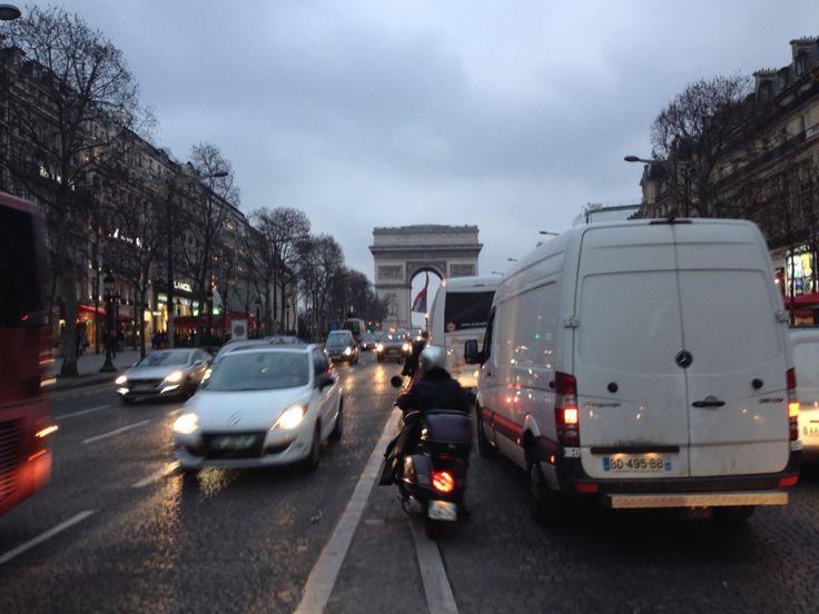 Champs Élysées featuring the Arc de Triomphe in the distance