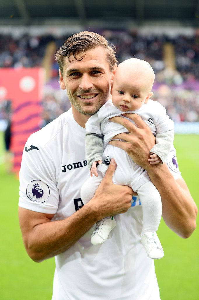 Fernando Llorente of Swansea City with his child before the Premier League match between Swansea City and Hull City at Liberty Stadium on August 20, 2016 in Swansea, Wales.