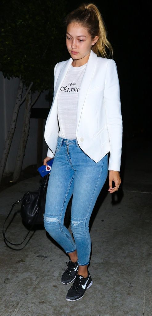 Gigi Hadid wearing Nike Flyknits with jeans and a blazer.