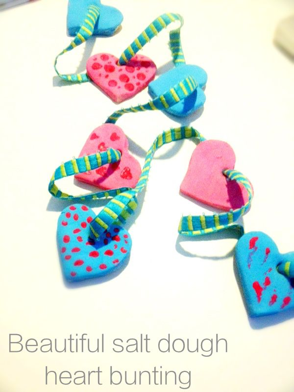 Beautiful salt dough heart bunting | Using a simple salt dough we've created really pretty strings of love heart bunting that look great hung in bedrooms or across windows. A nice kids Valentines craft | kids activities from Daisies & Pie