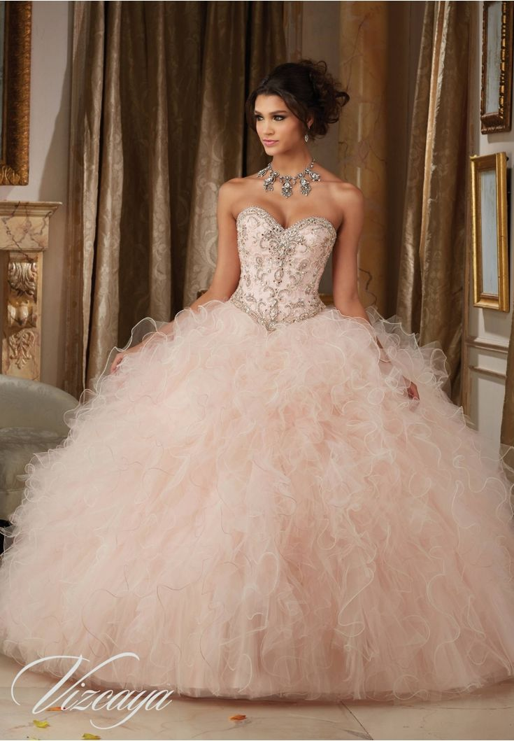 Quinceanera dresses by Vizcaya Dazzling Beaded Bodice on a Ruffled Tulle Ball Gown Matching Bolero Jacket. Available in Champagne/Blush, Mint Leaf/Scuba Blue, Champagne/Gold, White