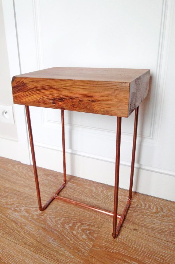 A side table made from antique reclaimed French Pine with lovely copper piped legs. A perfect piece for the home that would suit lots of