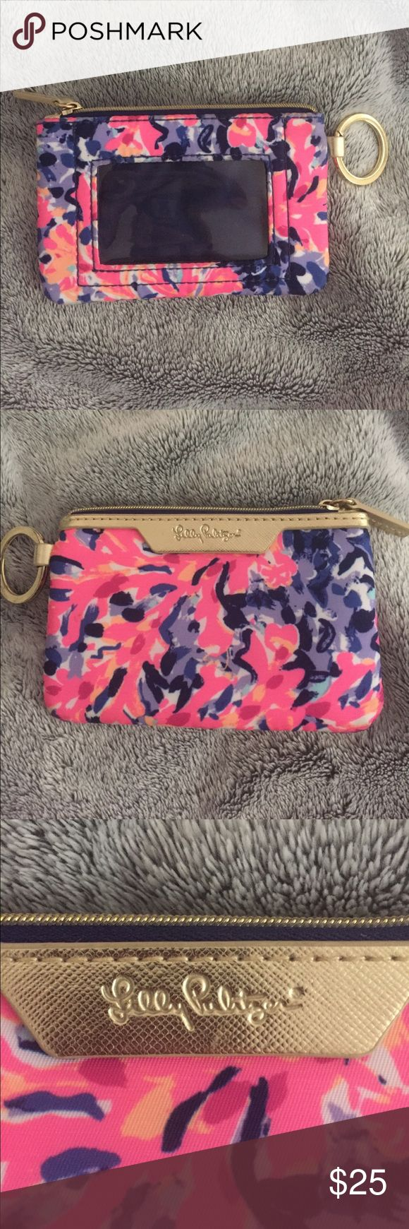 Lilly Pulitzer ID case/wallet ✨🎉Small Lilly ID case in need of a new home! Great for taking in a small over the shoulder purse! used for a short period of time. In great used condition, no rips or tears in the fabric, zip works perfectly! 🎉✨                    Pattern is Coco Crab! Lilly Pulitzer Bags Wallets