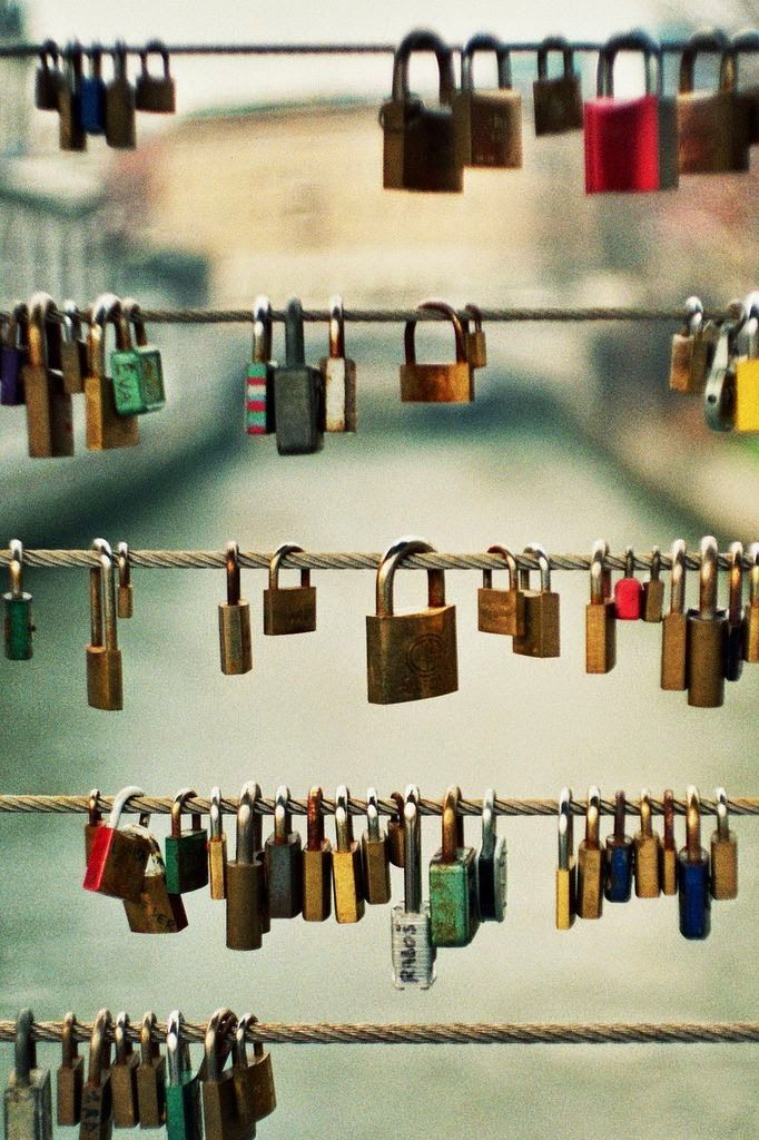 """The """"Love Lock"""" bridge in Hamburg Germany is just cool.  You buy a lock, have the local jewely etch your names on it, lock it onto the wire of the bridge and together toss the key in the water.  I was a neat experience."""